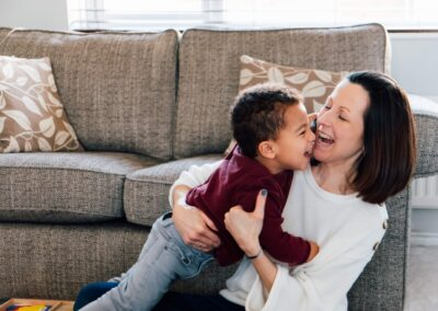 mum and toddler playing cuddling on floor in lounge