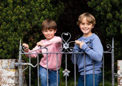 2 boys leaning on garden gate in Amersham Bucks