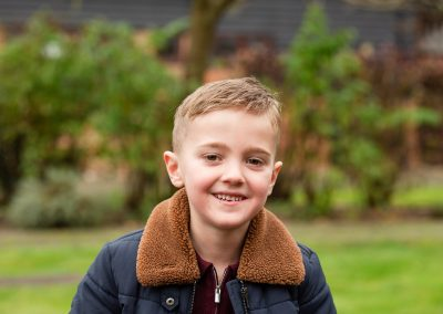child in autumn in warm coat for family photo session in Amersham
